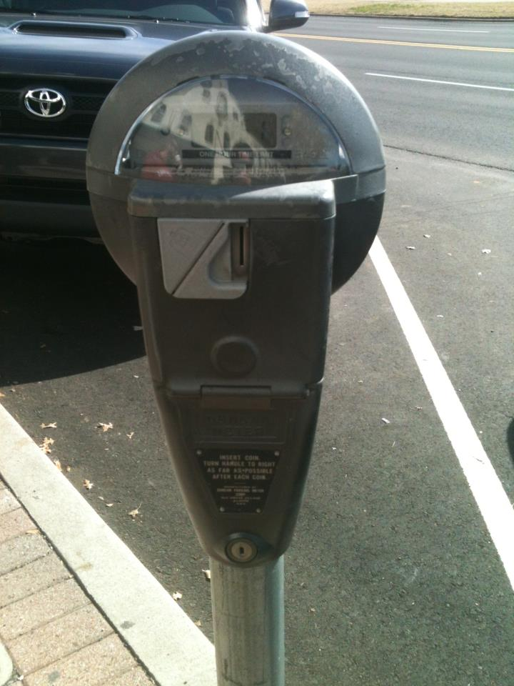 Team Kabbalah volunteer Cristee filled up a stranger's parking meter as a Random Act of Kindness in Norman, OK