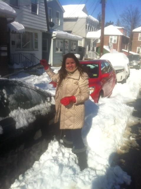 After a snowstorm, Claudia cleans off a random car
